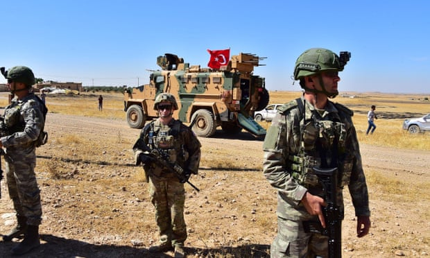 Trump's shock Syria retreat reverberates as Turkish troops mass