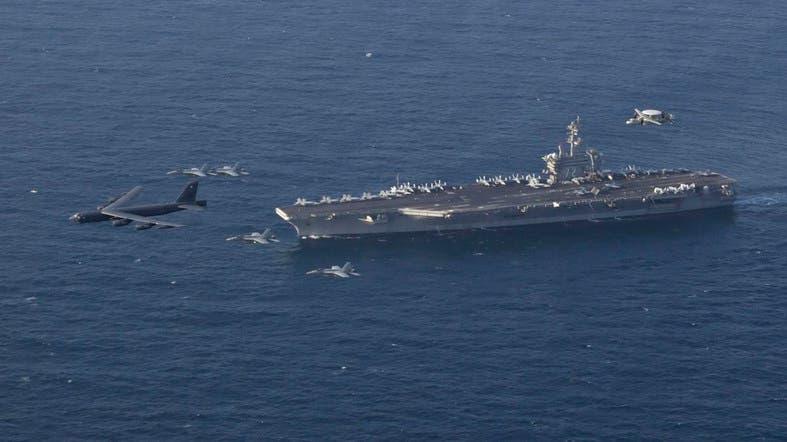 US aircraft carrier strike group sails through Strait of Hormuz