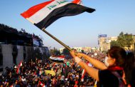 US urges early Iraq elections, halt to violence against protesters