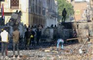 Grenade attack in Baghdad wounds nine security officials amid protests