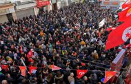 Tunisians demonstrating on revolution anniversary