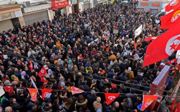 Tunisians demonstrating on revolution anniversary