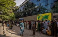 Glimpses of Kabul under the Taliban: Fighters patrolling roads, and lines at banks.