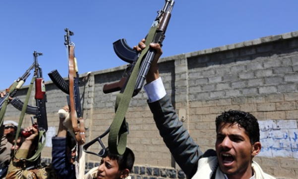 Houthis putting photos of military commanders on Yemeni school textbooks