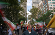 Protesters denounce the leaders of Brazil and Iran.