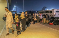 Rush of Afghan evacuees to Qatar leaves many crammed in hot hangar, facing an uncertain future