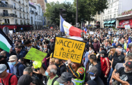 Demonstrations against France's vaccine pass surge for a third weekend, even as cases rise.